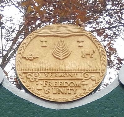 State Seal from atop a VT historical marker image. Click for full size.
