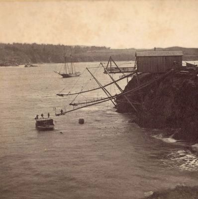 Boom and cable rigging in Mendocino Harbor image. Click for full size.