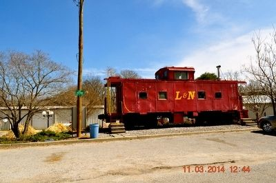 Red Caboose sitting on old train tracks image. Click for full size.