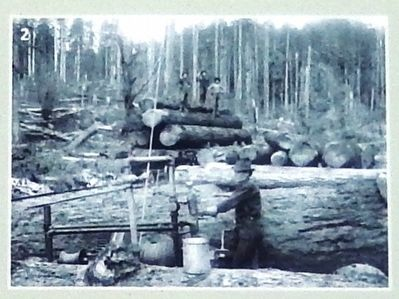 Marker Photo Detail: Loggers cutting and stacking timber image. Click for full size.