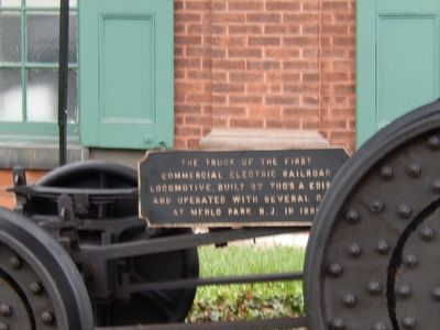 The Truck of the First Commercial Electric Railroad Locomotive. Marker image. Click for full size.