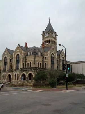 1892 Victoria County Courthouse with Marker to left of street lamp. image. Click for full size.