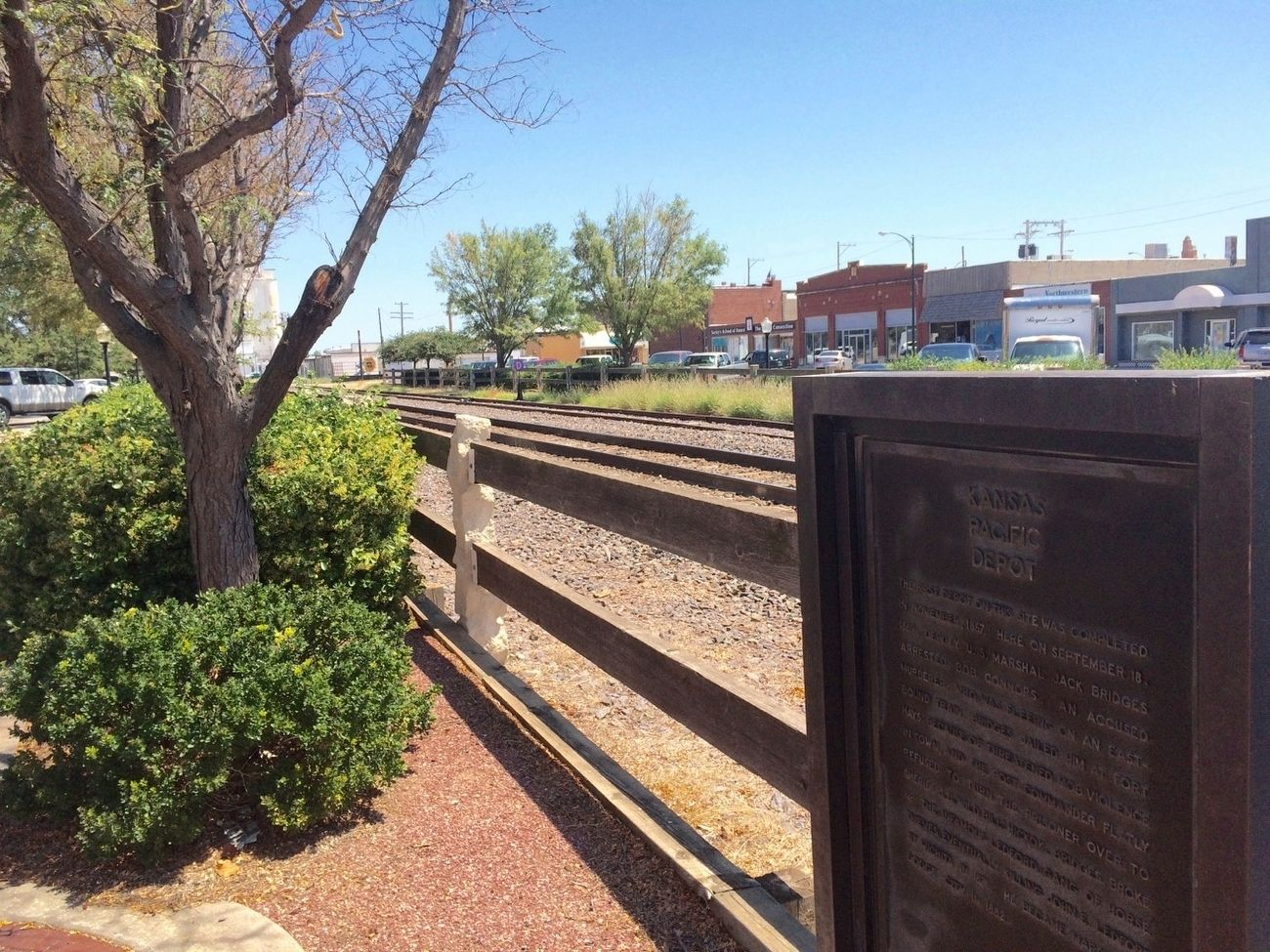 Kansas Pacific Depot Marker in front of train tracks in Union Pacific Plaza. image. Click for full size.
