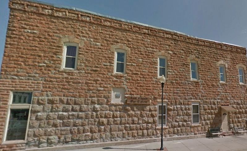 Side of Native Stone Building showing different color stone. image. Click for full size.