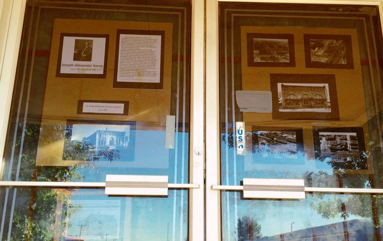 Historical photos, etc. on front doors of former Kemp Building. image. Click for full size.