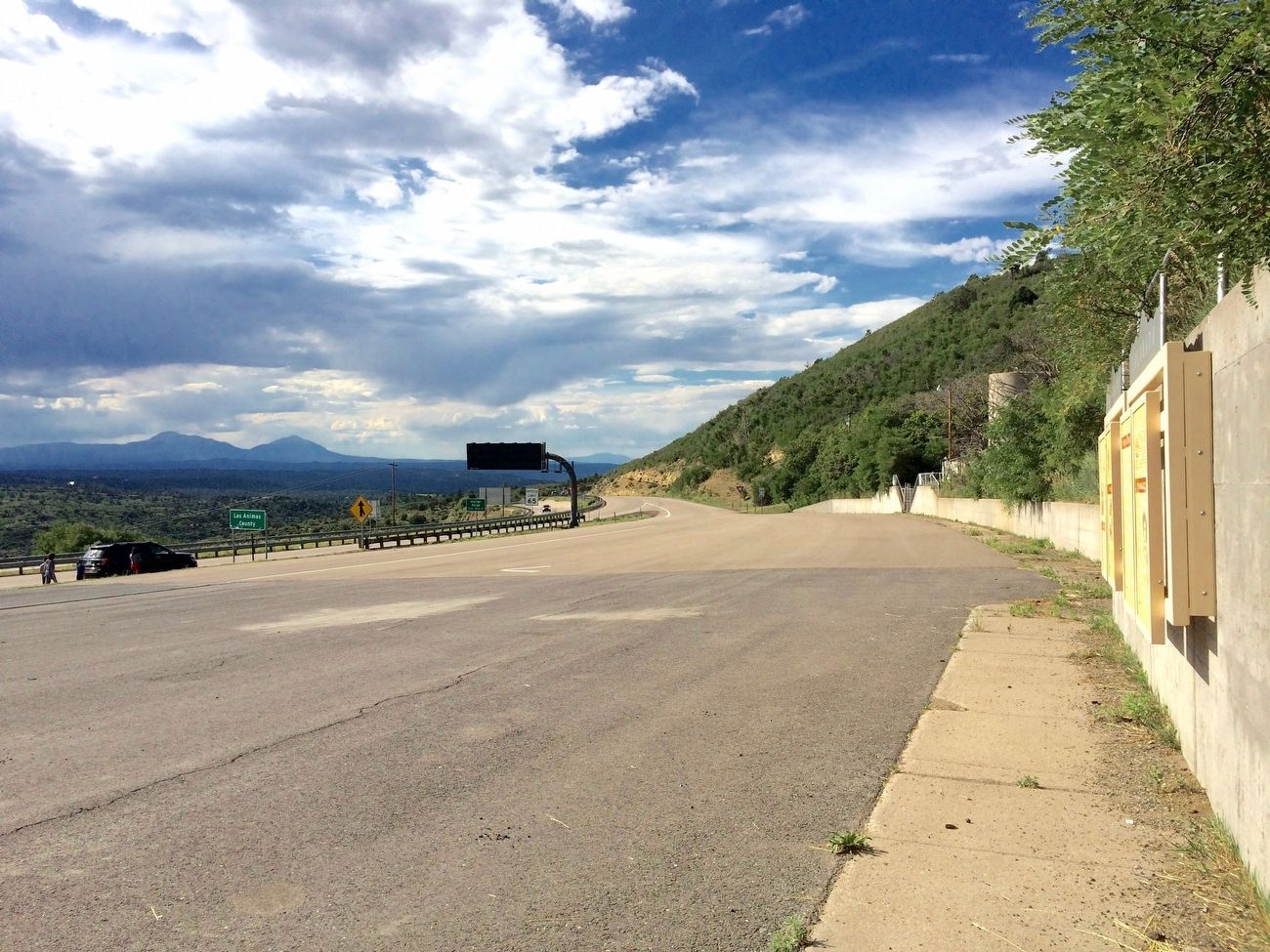 View from marker towards entrance ramp back onto I-25 in Colorado. image. Click for full size.