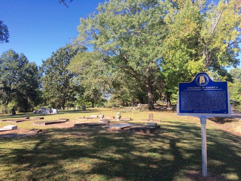 Lynching in America marker and the Rehobeth Missionary Church Cemetery. image. Click for full size.