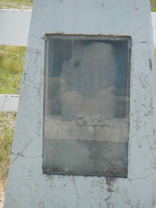 The original headstone enclosed in the 1926 monument. image. Click for full size.