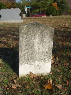 The Tombstone of Cpl Harris, as shown in the marker. image. Click for full size.