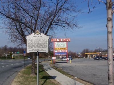 Marker with shopping center sign. image. Click for full size.