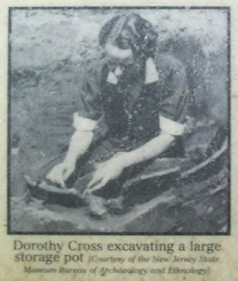 Dorothy Cross excavating a large storage pot image. Click for full size.