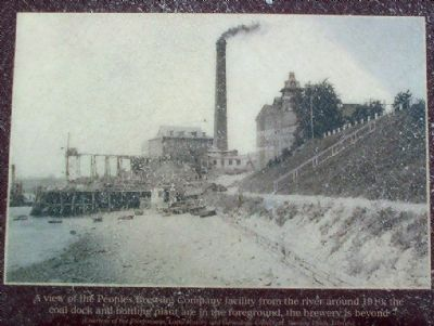 A view of the Peoples Brewing Company facility from the river around 1910; image. Click for full size.