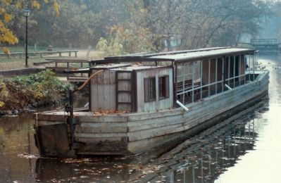 Boats similar to this were pulled through the locks and along the canal image. Click for full size.