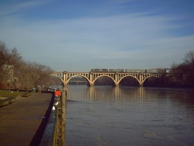Fredericksburg Railroad Bridge and modern freight train image. Click for full size.