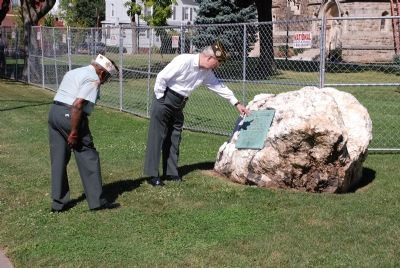 Two Veterans examine the marker in Summer 2007 prior to a local parade image. Click for full size.