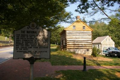Marker with historic cabin and building image. Click for full size.