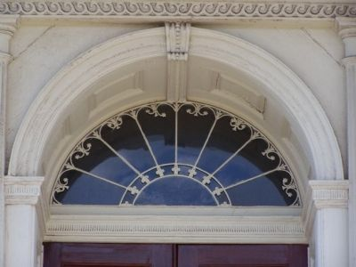 Window above the front entrance. image. Click for full size.