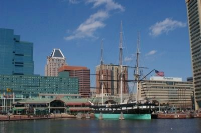 USS Constellation with Baltimore skyline in the background image. Click for full size.