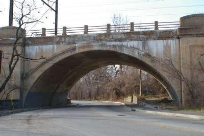 "View under the railroad bridge with ""Bridging Gwynns Falls"" marker in the distance image. Click for full size."