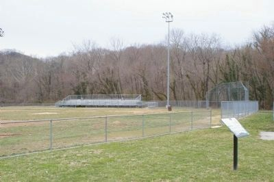 Leon Day Park Marker with baseball field in background image. Click for full size.