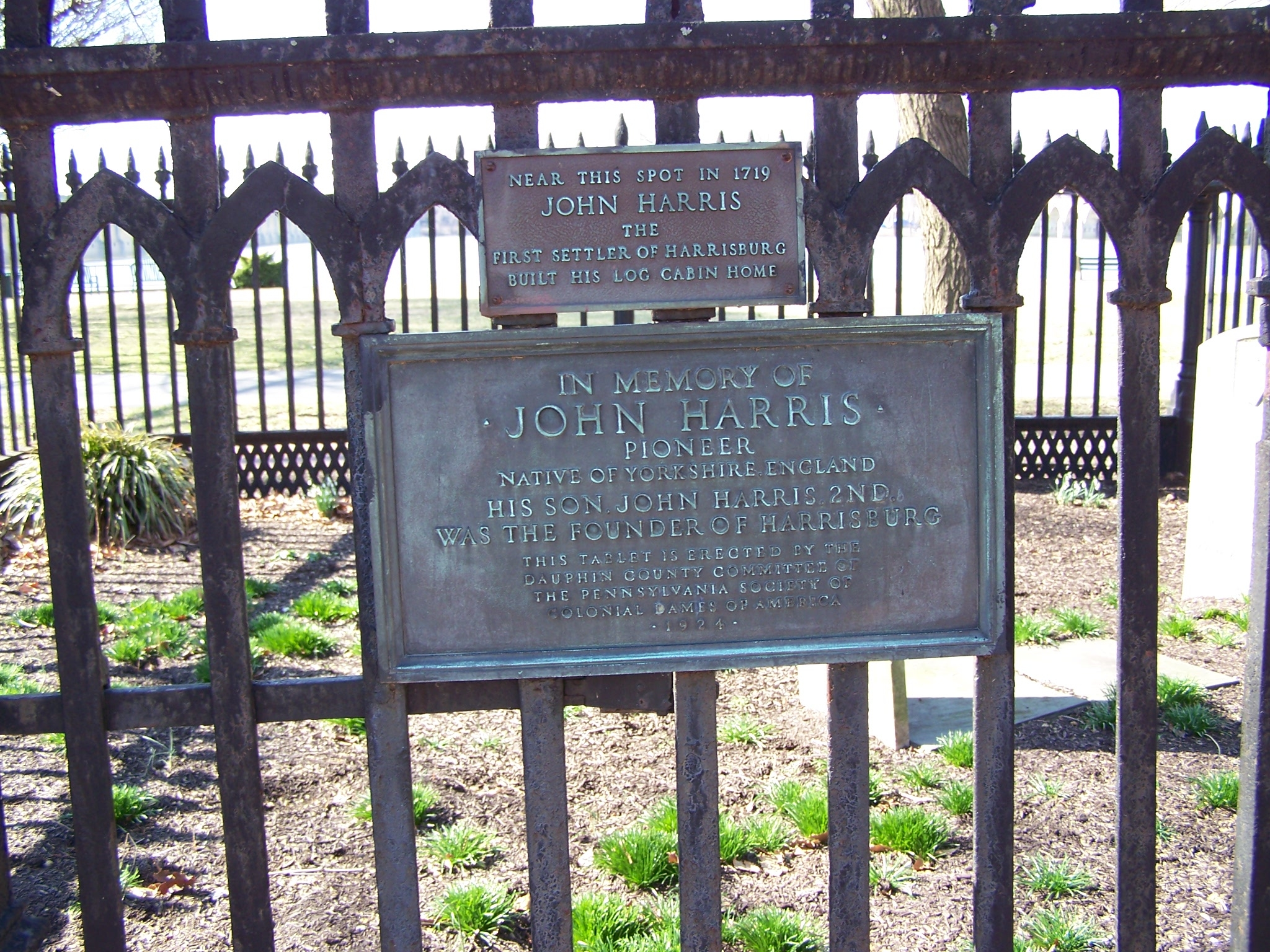 Plaques on burial plot fence