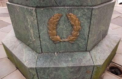 <i>Liberty in Distress</i> Wreath on pedestal beneath Lady Liberty image. Click for full size.