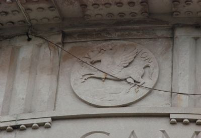 One of several Aviation symbols on the outside of the Greek Temple image. Click for full size.