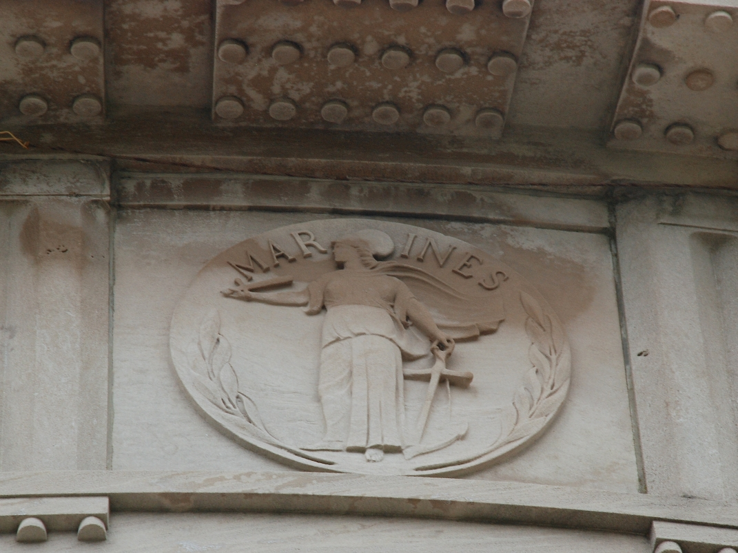 One of several duplicate Marine symbols on the outside of the Greek Temple