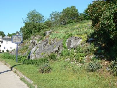 The fort marker on the rock face and the newer marker on the street. image. Click for full size.