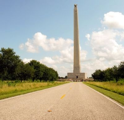 View of monument approaching from access road image. Click for full size.