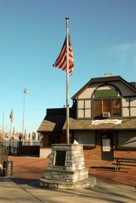 The plaque is at the base of the flagpole near the baseball diamond. image. Click for full size.