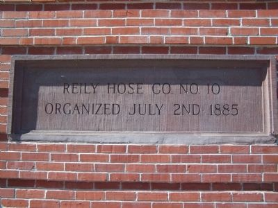 Plaque on wall of fire house image. Click for full size.