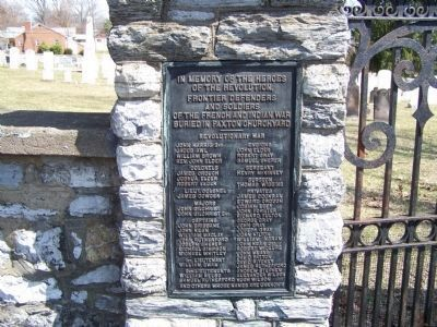 Plaque on left of cemetery gate. image. Click for full size.