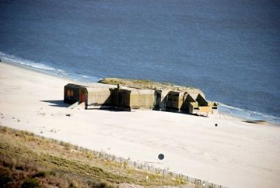 View of World War II gun emplacement from the top of the lighthouse. image. Click for full size.