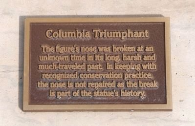 Plaque at base of statue explaining why Columbia doesn't get her nose fixed! image. Click for full size.