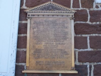 Plaque on wall of church image. Click for full size.