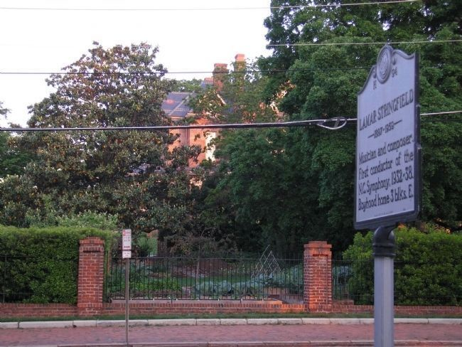 Lamar Stringfield Marker with Governor's Mansion visible behind it. image. Click for full size.