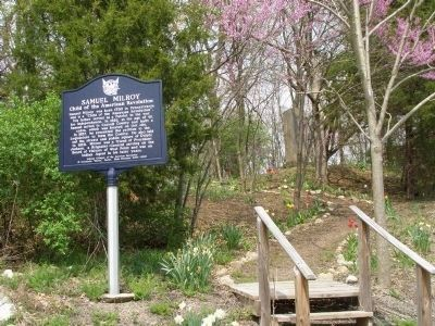 The Monument is on the hilltop behind this metal marker. image. Click for full size.