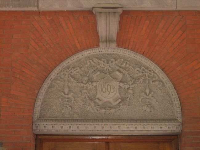 The intricately carved datestone on the Administration Building. image. Click for full size.