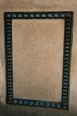 The Boy Scout oath is engraved on the pedestal of the statue image. Click for full size.