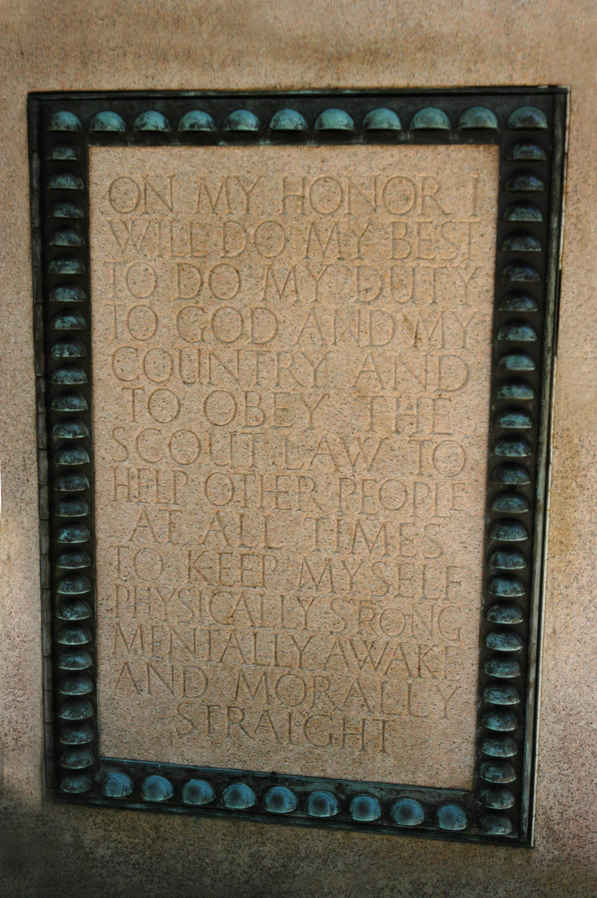 The Boy Scout oath is engraved on the pedestal of the statue