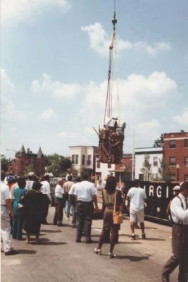 """The Spirit of Freedom"" is lowered into place at the still unfinished memorial image. Click for full size."