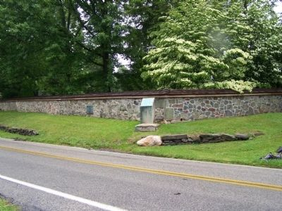 Birmingham Cemetery Wall with several markers visible. image. Click for full size.
