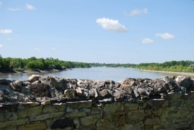 Red River beyond church wall image. Click for full size.