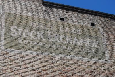 Faded sign on side of building image. Click for full size.