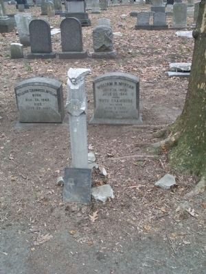 William R. McKean Marker leaning against marker post. image. Click for full size.