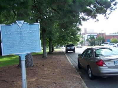 South Carolina Canal & Rail Road Company Marker, looking west along Park Ave. (Old Railroad cut) image. Click for full size.