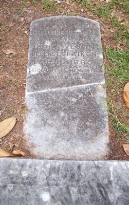 Defense of Aiken Marker broken off and settling flat , in the ground image. Click for full size.