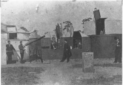 An 1882 picture of the German astronomers and their observatory at Aiken image. Click for full size.