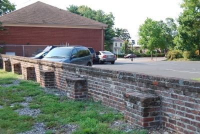 The remainng brick wall on the western side of the park. image. Click for full size.